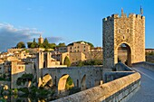 'Medieval Bridge (11th Century), in Besalu, a medieval village declarated Historical-Artistic Site, ubicated in La Garrotxa, Girona province. Catalonia; Spain.'