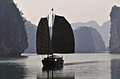 Vietnam, Ha Long bay a World heritage site of UNESCO, junk boat in the bay.