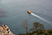 sightseeing boat surrounding the Rock of Ifach, Calpe, Alicante, Spain.