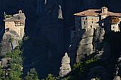 Greece, Thessaly, Meteora, World Heritage Site, Roussanou (Agia Barbara) nunnery and Agios Nikolaos Anapafsas (St Nicholas Anapausas) monastery.
