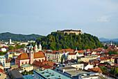 Slovenia, Ljubljana, cityscape with Franciscan church, Saint Nicholas church and the Castle.
