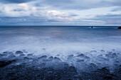 Hawaii, Maui, Kaupo, Rocky Ocean Shoreline At Evening, Long Exposure.