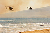 Hawaii, Maui, Ma'alaea, Fire Helicopters Collecting Ocean Water To Help Put Out Wildfire. Editorial Use Only.