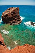 Hawaii, Lanai, Hulopoe Bay, View Of Pu'u Pehe Rock (Sweetheart Rock), Man Stand-Up Paddle Boarding.