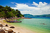 Thailand, Phuket, Paradise Beach, Longtail Boats And Idealic Bay Scene.