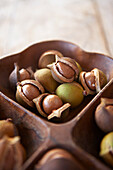 Hawaii, Oahu, Macadamia Nuts In A Beautiful Wooden Platter.