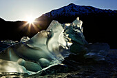 Tongass Forest, Alaska, Recently Calved From The Terminus Of Mendenhall Glacier In Mendenhall Lake, An Iceberg Transmits The Light From The Setting Sun.