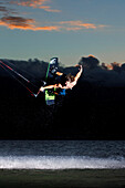 Hawaii, Maui, Professional Kiteboarder Jesse Richman Riding At Kitebeach At Night. For Editorial Use Only.