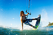 Hawaii, Maui, Professional Kiteboarder Jesse Richman Riding At Kitebeach. For Editorial Use Only.