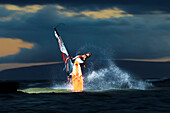 Hawaii, Maui, Kihei, Professional Windsurfer Dean Christener Sailing At Sunset. For Editorial Use Only.
