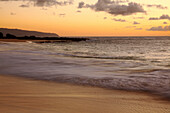 Hawaii, Blur Of Waves Crashing On The Beach At Sunset