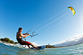Hawaii, Maui, Professional Kiteboarder Patri Mclaughlin Riding At Kitebeach. For Editorial Use Only.