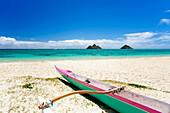 Hawaii, Oahu, Lanikai Beach, Colorful Outrigger Canoe On Sandy Shore, Mokulua Islands In Distance.