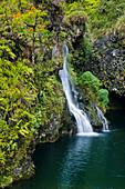 Hawaii, Maui, Hana Coast, Hanawi Falls, View Of Waterfall Flowing Into Pool Of Water.