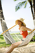 Hawaii, Oahu, Attractive Young Woman Laying In A Hammock.
