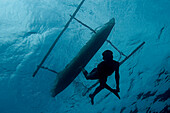 Indonesia, Pura Island, Native Freediver Swims Down From His Canoe, View From Below.