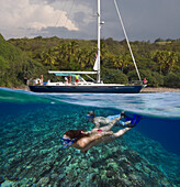 Hawaii, Maui, Honolua Bay, Snorkelers Underwater And Sailboat Above.