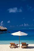 French Polynesia, Bora Bora, Chairs And Umbrella On Deserted Beach, Blue Sky, Water, White Sand