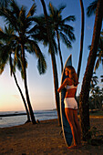 Hawaii, Oahu, North Shore, Full Length View Woman With Surfboard Palms Golden Afternoon Light D1077