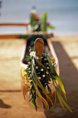 Koa Canoe With Ti Leaf And Kukui Nut Leis On Hull Afternoon Light Selective Focus Blurry Background D1465