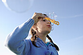 Young Girl Blowing Bubbles, Stayner, Ontario