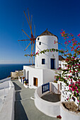 View Of A Building In The Village Of Oia Perched On Steep Cliffs Overlooking The Submerged Caldera, Santorini, Greece