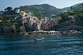 Two Local Fisherman In The Bay Of Riomaggiore Cinque Terre Region In Western Italy.