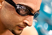 Close Up Of A Man In Goggles After Swimming