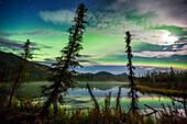Aurora Borealis Over Small Taiga Pond In The Brooks Range Mountains In Arctic, Alaska.