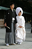'After The Traditional Japanese Shinto Wedding Ceremony Families Gather For A Formal Portrait Sitting, At Meiji Jingu Shrine; Near Harajuku Station; Tokyo. Here The Bride And Groom Pose For A More Informal Shot After The Formal Photo Sitting.There Are Sev