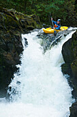 'England, Cumbria, Lake District National Park, Canoeist going down Skelwith Force waterfall; Langdale'