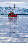 A Midnight Cruise Around The Ilulissat Ice Fjord, One Of Unesco World Heritage Sites. Greenland.
