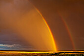 'Double rainbow over a prairie field after a storm; Val Marie, Saskatchewan, Canada'