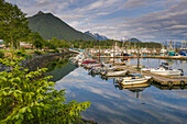 'Commercial fishing boats in Crescent Harbour in the small, coastal town of Sitka; Sitka, Alaska, United States of America'
