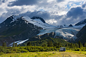 Scenic view of the Richardson highway and the Worthington glacier with a travel van in the foreground, Southcentral Alaska.