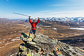 Male hiker on a mountain ridge of the Brooks range, Gates of the Arctic National Park, Alaska.