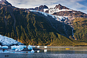 Sea Kayakers explore the tidewater Harriman glacier, Harriman Fjord, Chugach mountains, Chugach National Forest, Prince William Sound, southcentral, Alaska.