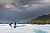 Hikers travel the aufies on the Marsh Fork of the Canning river, Arctic National Wildlife Refuge in the Brooks range mountains, Alaska.