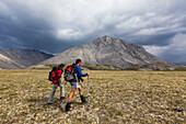 Hikers along the Marsh Fork of the Canning river in the Arctic National Wildlife Refuge in the Brooks range mountains, Alaska.