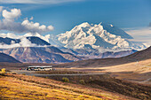 Tourists on buses stop at the Stoney Dome lookout to view Mt Mckinley, Denali National Park, interior, Alaska.