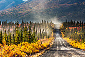 Vehicle travels the Denali Highway, a gravel road transecting the Parks and Richardson highways, southcentral Alaska.