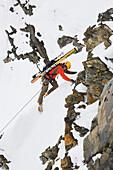 Man lead climbs a route in the Alaska range mountains, interior, Alaska.