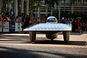 'Solar car departing on the road; Darwin, Australia'