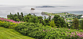 'View of Perce Rock through the fog from Mont-Sainte-Anne; Perce, Quebec, Canada'