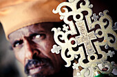 'Orthodox priest with ceremonial cross; Ethiopia'