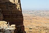 'Tourist trekking in the amazing mountain scenery on the Gheralta plateau; Tigray region, Ethiopia'