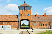 'Main entrance of Birkenau death camp viewed from inside front gate; Osweciem, Poland'