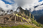 'Morning fog and clouds reveal Machu Picchu, the ancient lost city of the Incas, one of Peru's top tourist destinations; Peru'