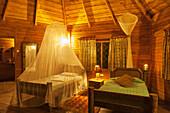 'Mosquito nets over the beds in Jacana Lodge; Uganda'