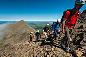 'Climbers going up ridge in the Black Cuillin; Isle of Skye, Scotland'